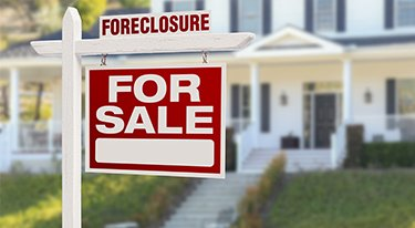Foreclosure Sign in Front of a House - Our Real Estate Attorneys in Bergen County & Essex County Can Help