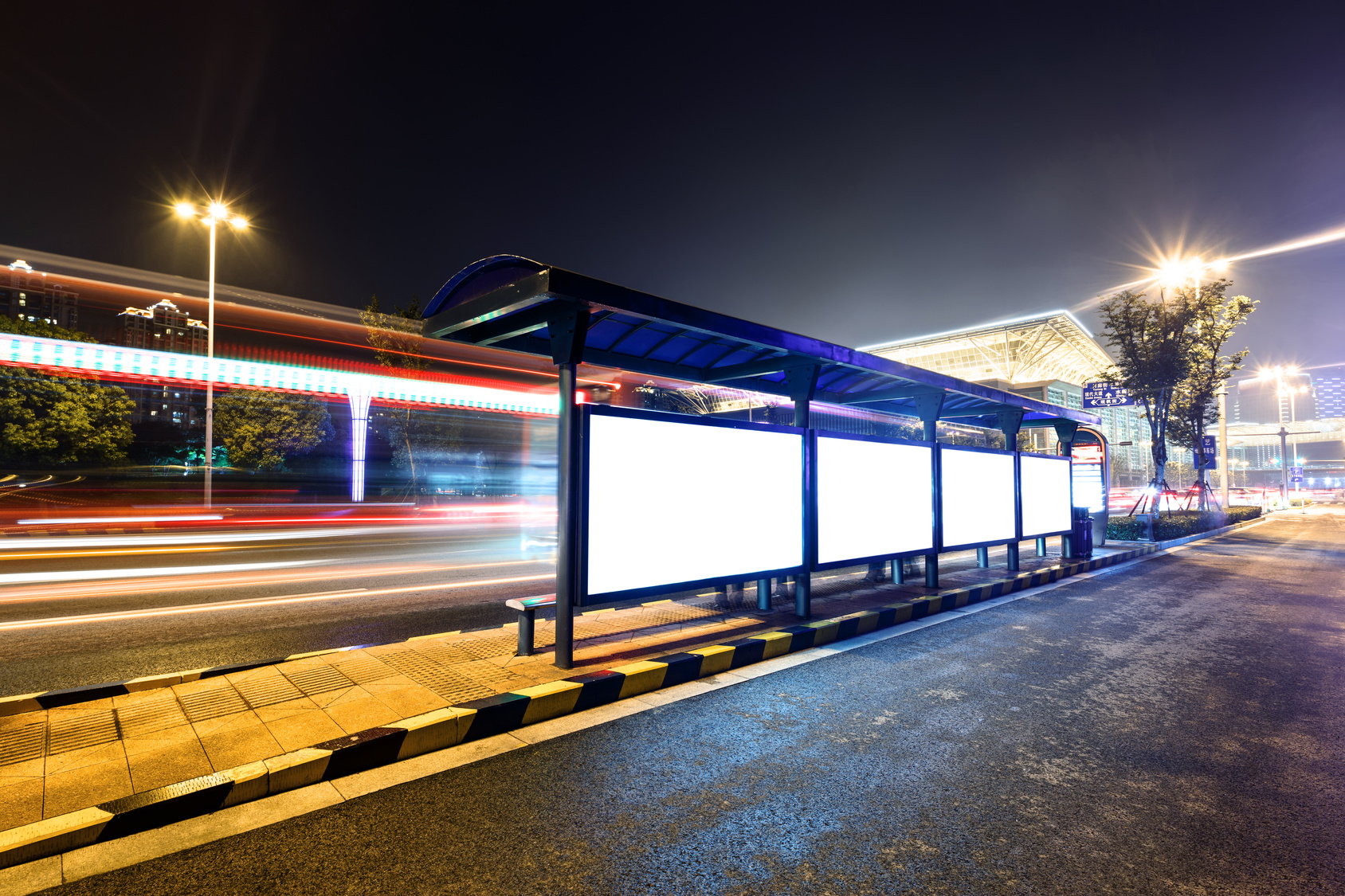 Train passing outdoor stop at night | Railroad accident lawyers NYC